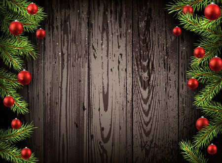 ligneous: Christmas wooden background with fir branches and balls.
