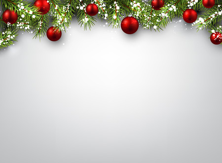 winter holiday: Christmas background with fir branches and red balls.