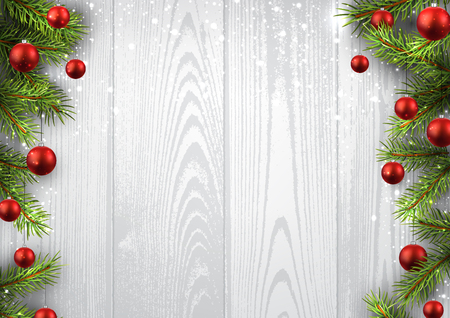 december background: Christmas wooden background with fir branches and balls.