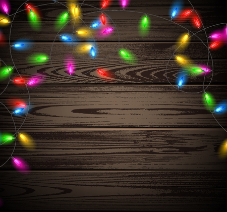 wooden color: Wooden background with Christmas garland of color lights.