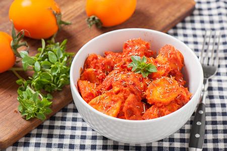 Potatos Bravos with oregano and yellow tomatoes Stock Photo