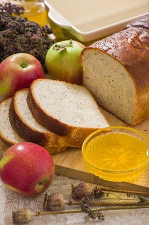 Homemade bread with poppy seeds with honey and apples