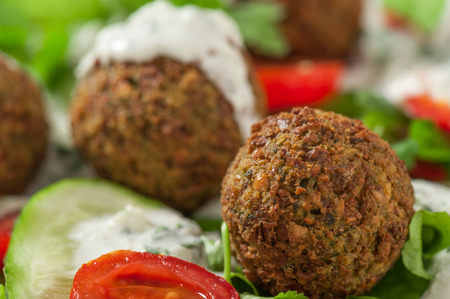 Falafel on salad leaves with tomatoes, cucumber and pepper
