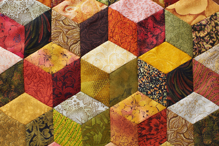 Detail of quilt sewn from pieces as diamonds Stock Photo