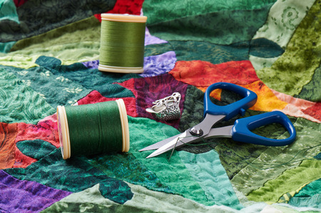 Detail of the quilt with thread and scissors