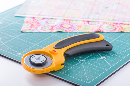 Rotary cutter on plan front on green mat