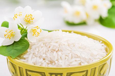 Bowl with rice jasmine  and jasmine flower