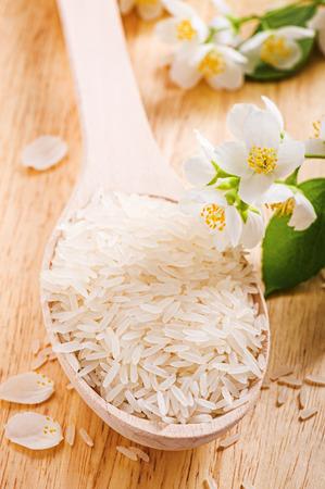 Spoon with rice jasmine  and jasmine flower