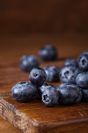 Blueberries on a wooden cutting board closeup