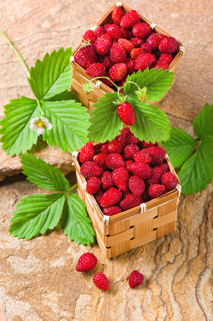Strawberries in a baskets on a stone