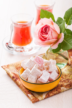 Bowl with diced Turkish delight, tea and rose
