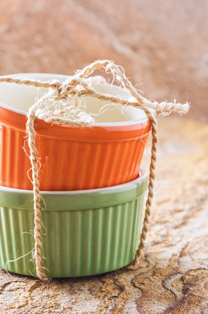 Orange and green cocotte rope tied on stone Stock Photo