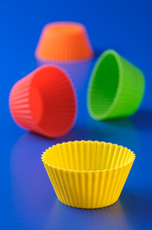 Bright colored silicone baking cupcakes and muffins photo