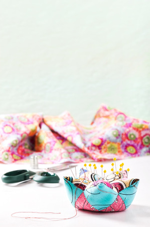 Accessories for sewing on a white surface