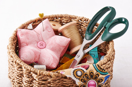 Accessories for sewing in a wicker basket