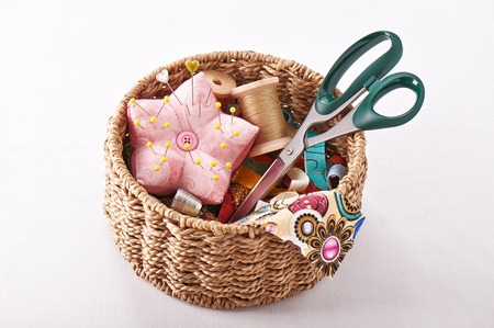 Accessories for sewing in a wicker basket photo