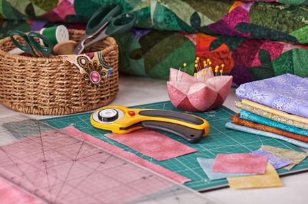 Accessories for patchwork while working on a quilt Stock Photo