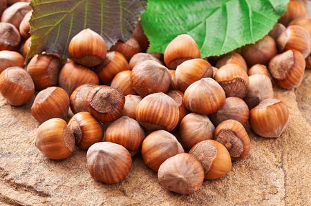 cobnut: Heap of hazelnuts on a stone closeup Stock Photo