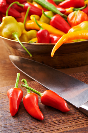 Colorful fresh peppers on a wooden surface