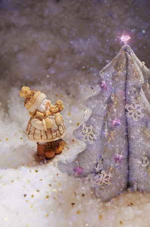 miracle tree: Miracle shiny Christmas tree and funny snowman Stock Photo