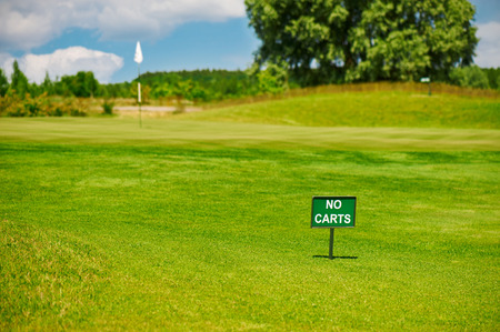 caddie: No carts sign on the golf field