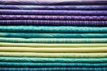 vibrant background: Heap of colorful fabric as a vibrant background image by shallow depth of field focus Stock Photo