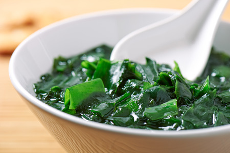 Traditional Japanese soup made of seaweed wakame in white bowl