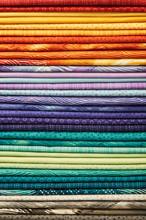 Heap of colorful fabric as a vibrant background image by shallow depth of field focus Stock fotó