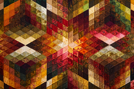 Detail of the quilt from diamond pieces of fabric