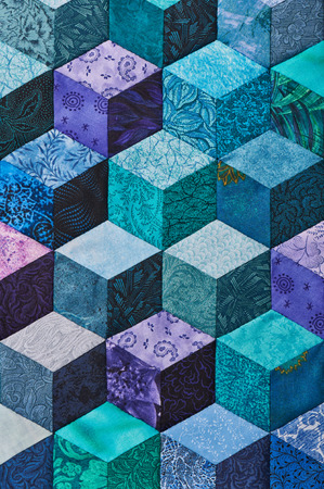 Detail of quilt sewn from rhombuses and has view 3D