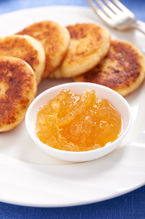 Cheese pancake on a plate with lemon jam at breakfast