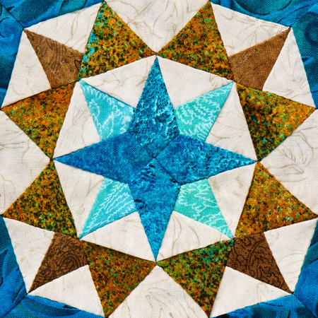 Detail of the quilt from pieces of fabric