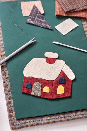 Applique tools for fabric and detail of applique Stock Photo
