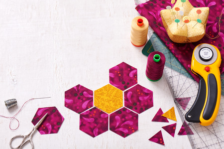 Preparation of hexagon pieces of fabric for sewing a quilt Grandmothers Flower Garden