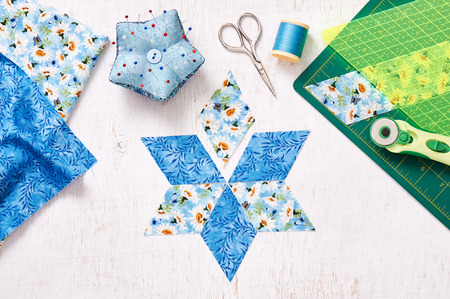 Prepare of diamond pieces of fabric for sewing quilt, top view