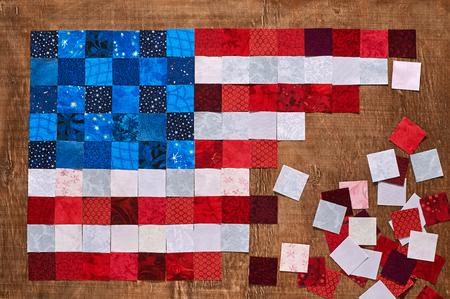 Square pieces of fabrics lying like a flag of USA