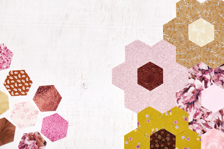 Abstract background of hexagonal pieces of fabric Grandmothers Flower Garden quilt Stock Photo