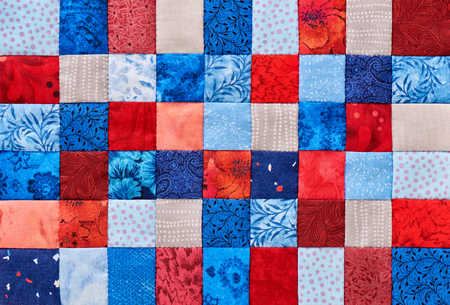 Blue and red square pieces of fabric sewn together