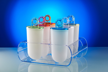 Plastic ice cream lolly form molds stand on plexiglass stand Stock Photo