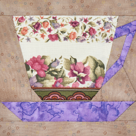 Patchwork block of the cup with a pattern of flowers Stock Photo