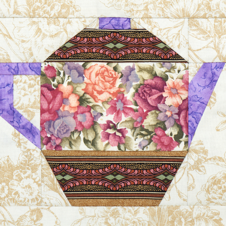 Patchwork block of the teapot with a pattern of flowers