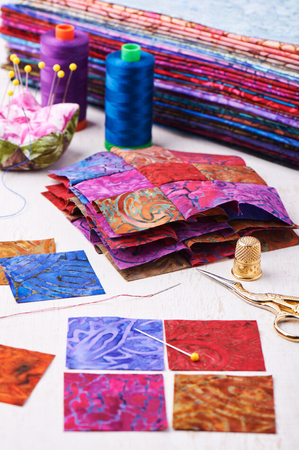 Sewing patchwork blocks to colorful batik quilt