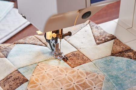 Modern sewing machine  working on a patchwork block of quilt Stok Fotoğraf