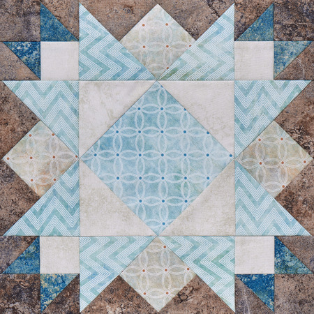 Patchwork geometric block from pieces of fabrics, detail of quilt Stock Photo