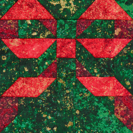 Patchwork block the red bow on a green background Stock Photo