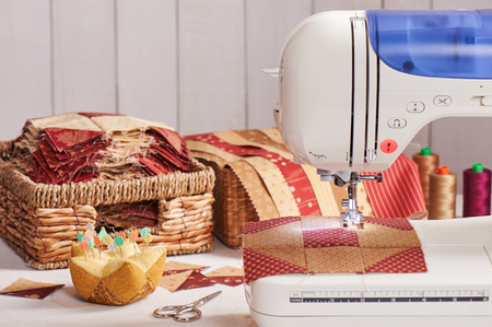 Quilt blocks sewing with an electric sewing machine, pile ready blocks Stock Photo