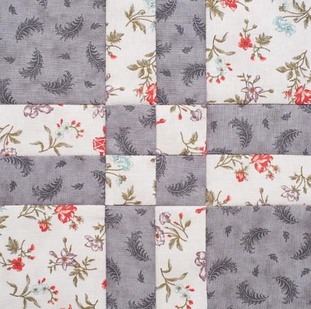 Bloque de mosaico geométrico pastel de piezas de telas, detalle de colcha, close-up