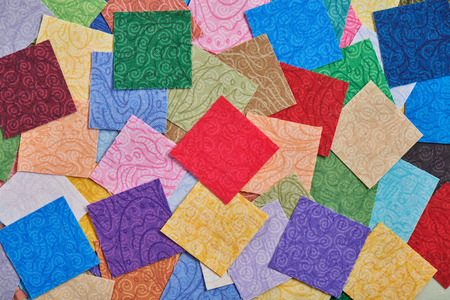 Heap square pieces of colorful fabrics for making quilt Imagens - 119192046