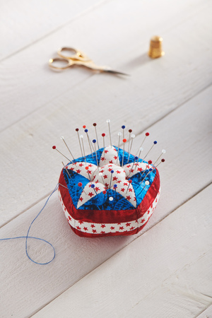 Pin cushion stylized elements of American flag, sewing accessories