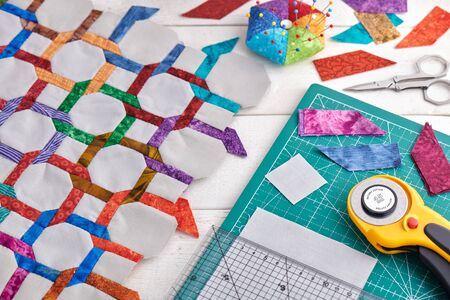 Quilting and sewing accessories, fragment and details of quilt Banco de Imagens